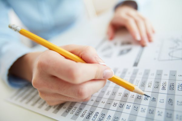 Close-up image of a financial worker analyzing statistical data